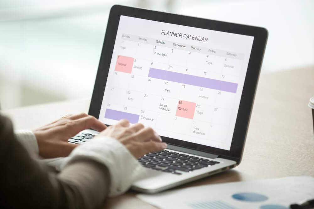Businesswoman planning day using digital planner