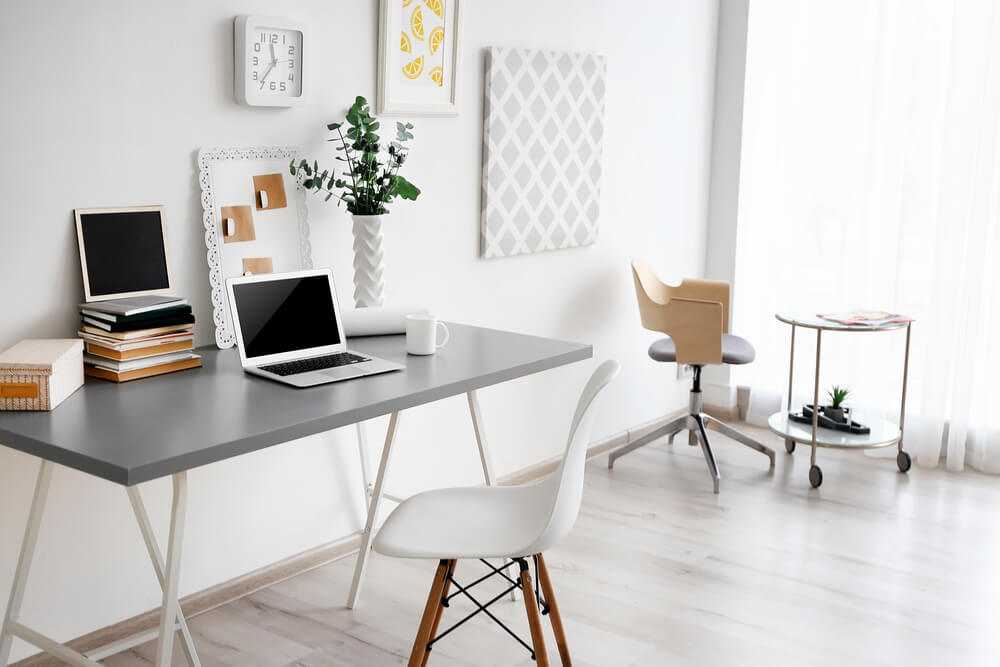 Comfortable workplace with laptop at home