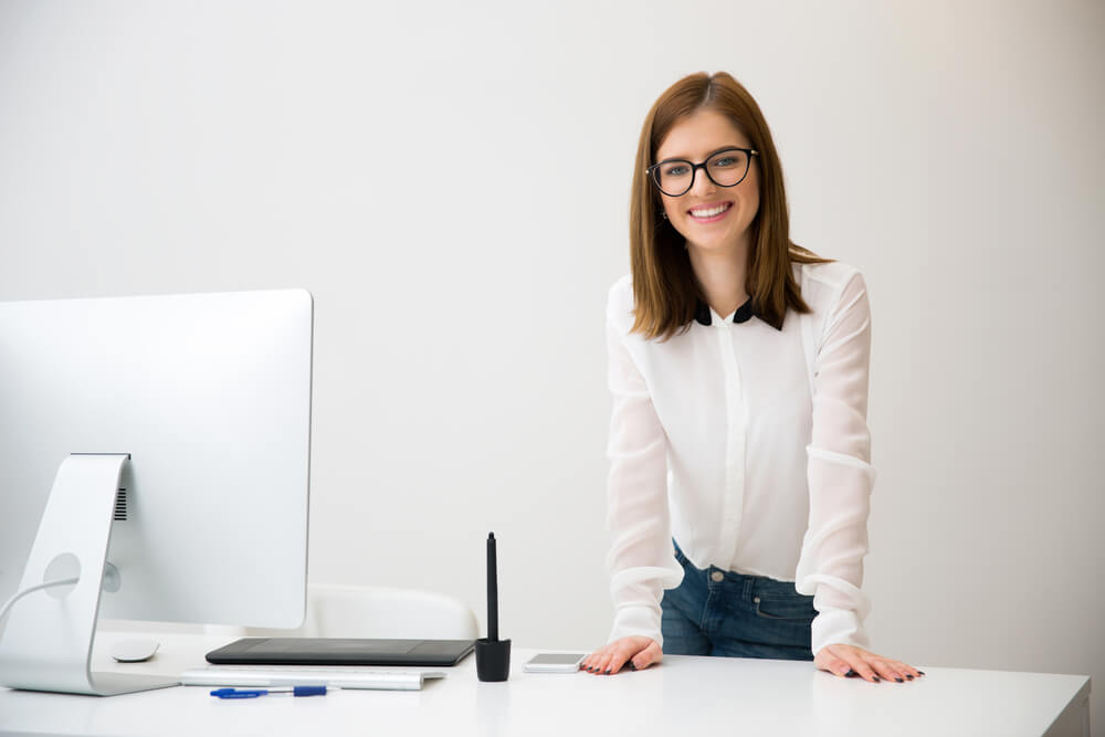 businesswoman is standing at her ergonomic workplace