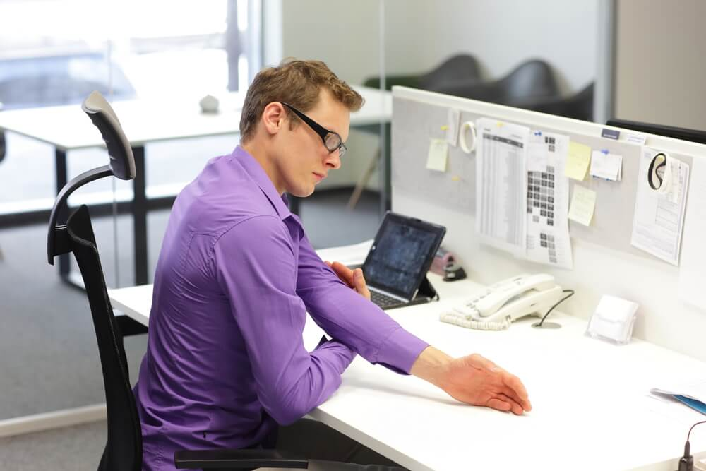 office employee is exercising during work