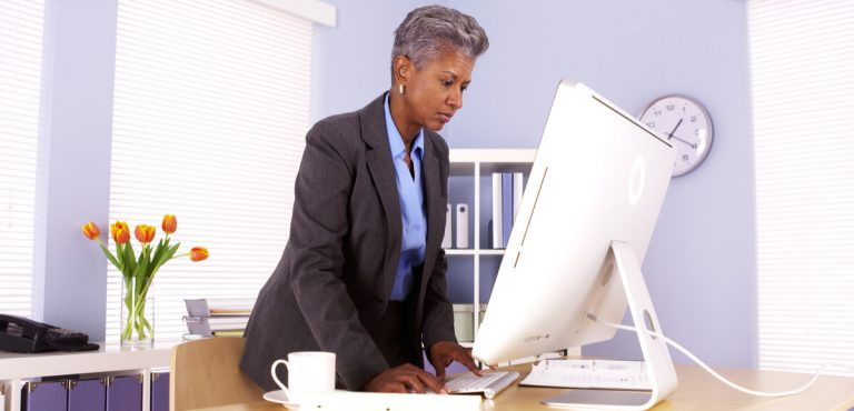 Senior African businesswoman working at desk