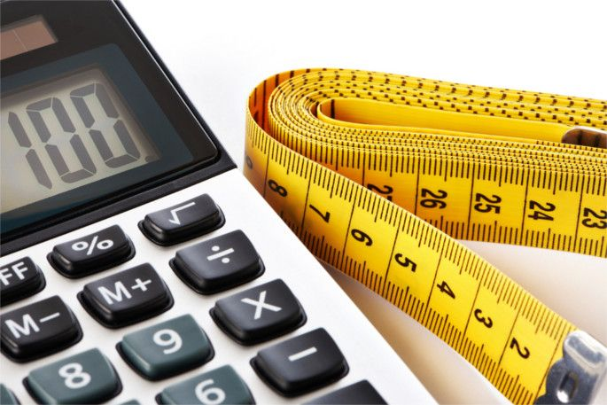 Centimeter and calculator isolated on white background