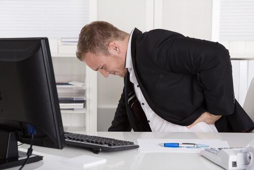 office man having back pain