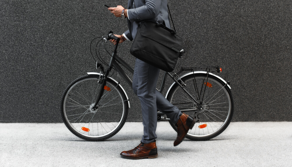 Businessman going to office by his bicycle