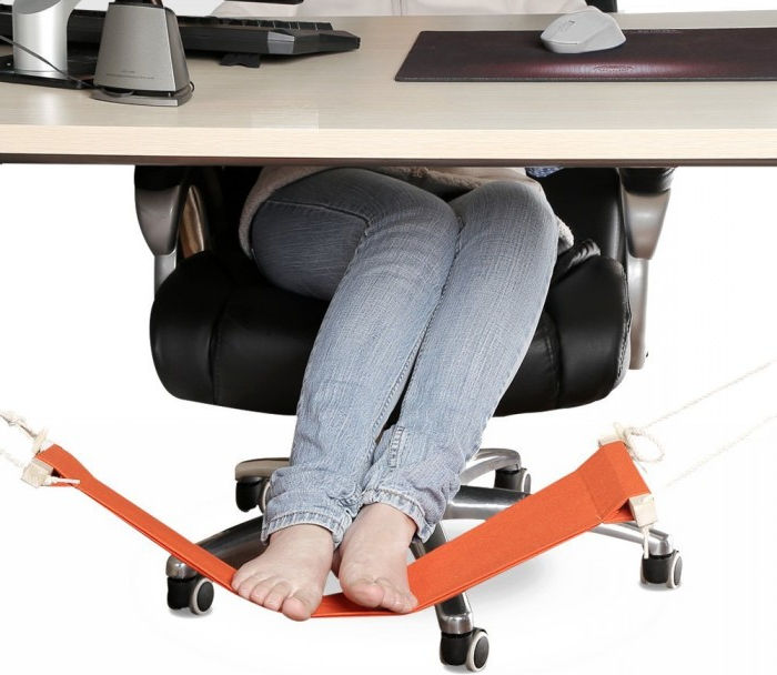 Woman is using Smagreho-Portable-Mini-Office-Stand-Desk-Foot-Hammock