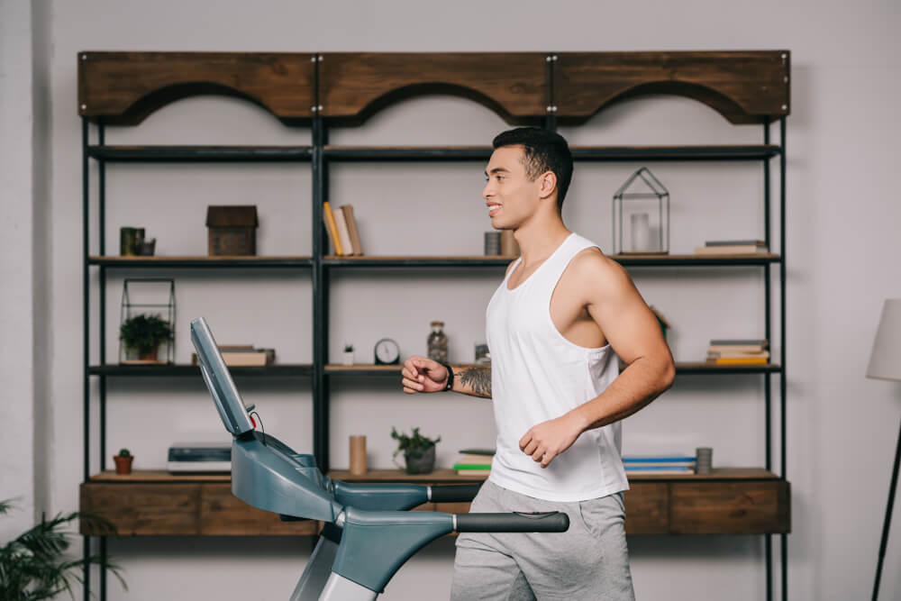 asian man running on treadmill workstation