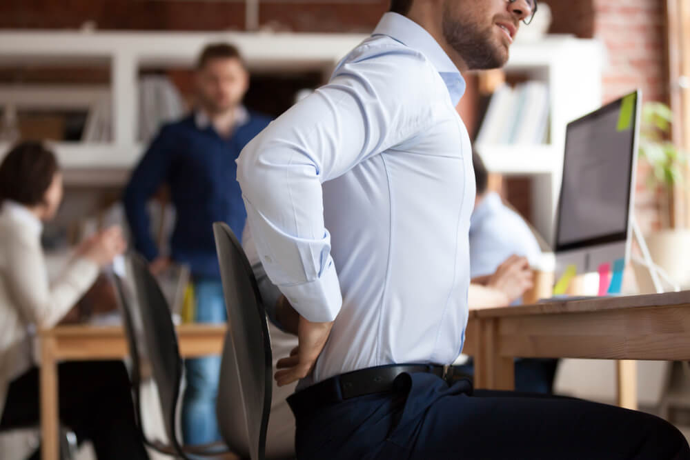 Businessman suffers from lower back pain