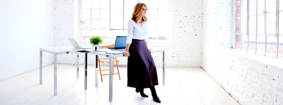 young businesswoman standing at office desk