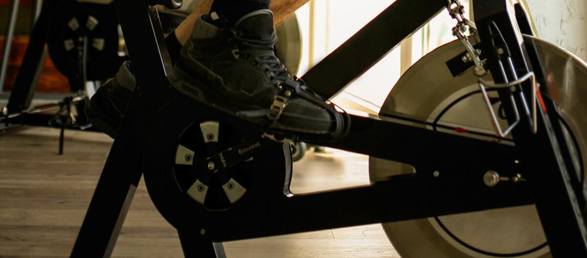 man working out on under desk elliptical machine