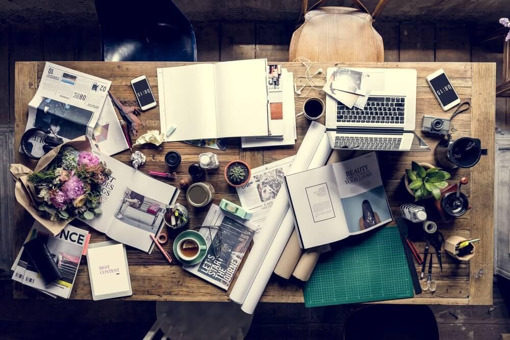 messy wooden standing desk workspace