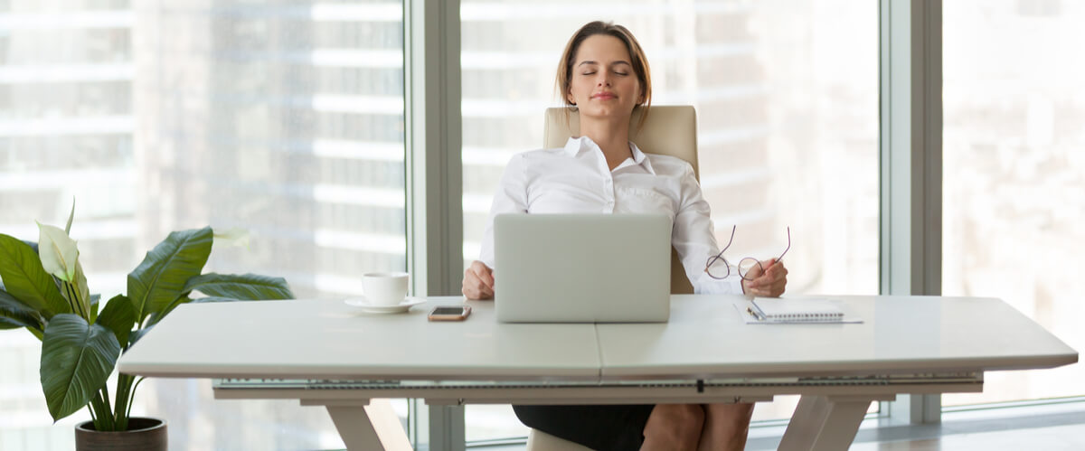 Young businesswoman relaxing leaning on comfortable ergonomic chair